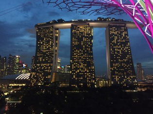 View of the Marina Bay Sands Hotel, infinity pool and Ce La Vi club up top